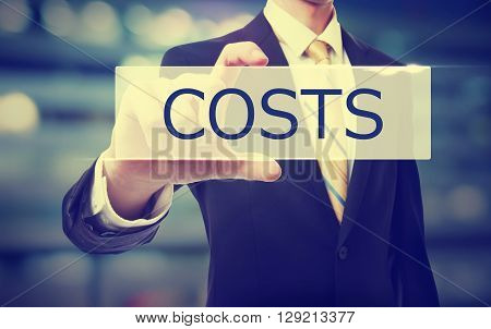Business Man Holding Costs