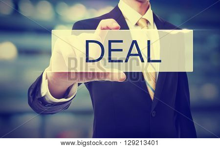 Business Man Holding Deal