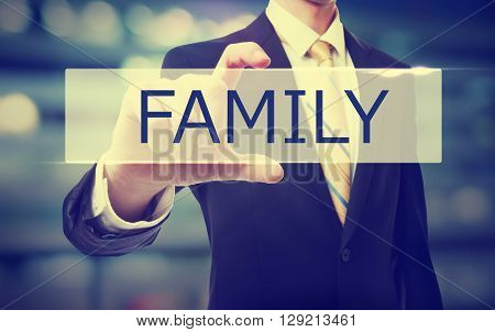 Business Man Holding Family