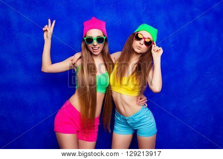 Trendy Hipster Girls In Hats And Glasses Gesturing And Pouting
