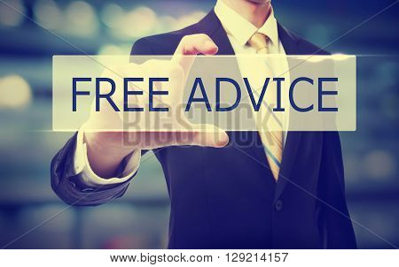 Business man holding Free Advice on blurred abstract background