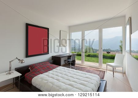 Interiors of new apartment, single bed with quilt of a bedroom