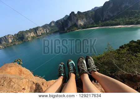 two rock climbers legs at seaside mountain rock