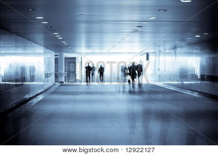 motion blurred of people walking in subway