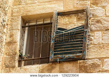 Old broken window in a building in the Old City in Jerusalem, Israel.