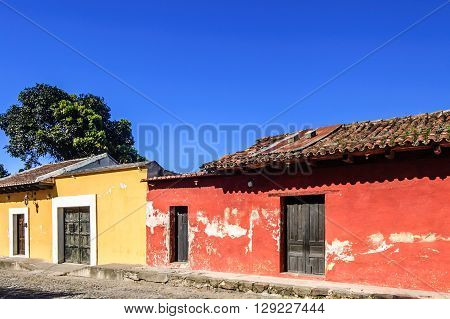Old colorful painted houses along cobbled street in colonial city of Antigua Guatemala