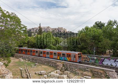 Passing train through Athens Ancient Agora with Acropolis in the background. Photo taken in spring 2016