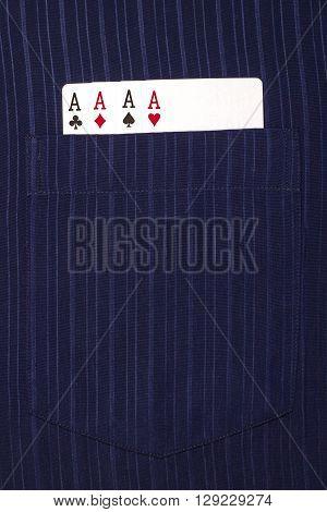 four ace cards inside front pocket blue male shirt closeup