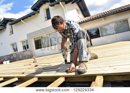 Carpenter building wooden deck
