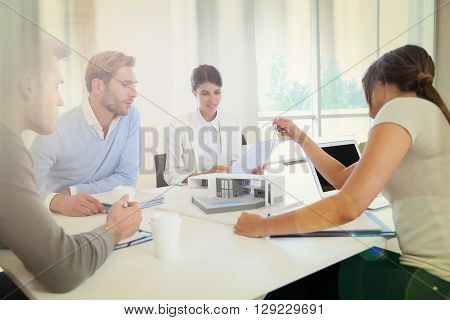 Team of architects meeting around table to talk about project