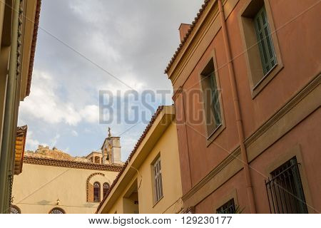 Plaka District In Athens Greece, With Church And The Acropolis In The Background