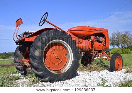 DOOR COUNTY WISCONSIN: October 5, 2016: An old orange Allis Chalmers tractor which was a company  that manufactured farm equipment ,and is now a part of Allis Chalmers energy and  AGCO.