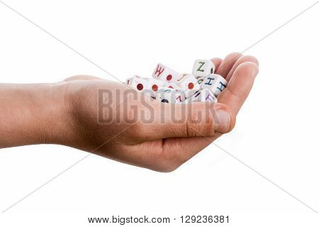 Hand holding colurful cube letters on white background