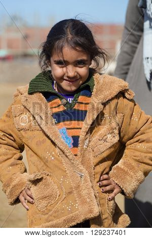 DARAW, EGYPT - FEBRUARY 6, 2016: Portrait of local girl posing for camera.