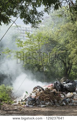 Burning pile of garbage, cause of air pollution
