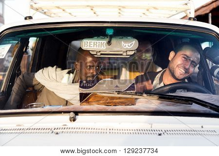 DARAW, EGYPT - FEBRUARY 6, 2016: Cab driver with passengers.