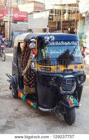 DARAW, EGYPT - FEBRUARY 6, 2016: Tuk-tuk vehicle parked on the street.