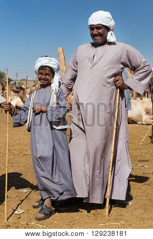 DARAW, EGYPT - FEBRUARY 6, 2016: Local camel salesmen on Camel market posing for camera.