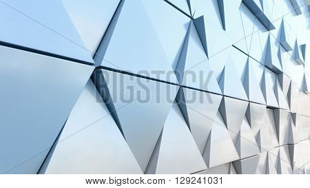 Abstract close-up view of modern aluminum ventilated triangles on facade
