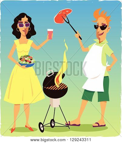 Couple at a barbecue party. Smiling man holding a piece of meat over a flaming grill, woman carrying a bowl of salad and a drink