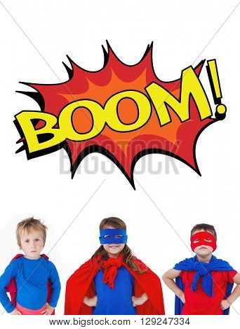 Children dressed as superman against the word boom