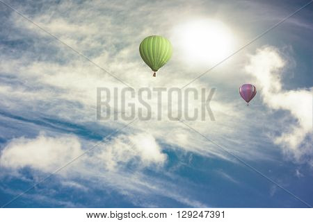 Colorful hot air balloons high in the sky and clouds
