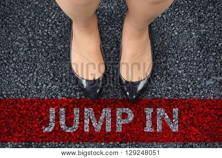 Businesswomans feet against black road