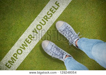 Woman wearing trainers against green background