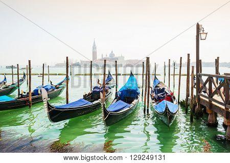 Gondolas Moored Near San Marco Square In Venice, Italy