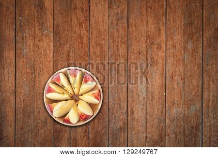 Top view of sliced apple on wooden background, stock photo