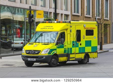 LONDON UK - 5TH APRIL 2014: A London Emergency Ambulance on a road during the day