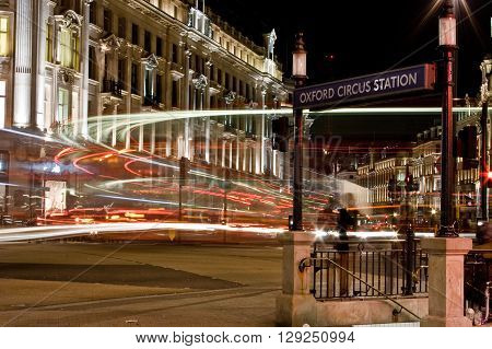 LONDON UK - 19TH APRIL 2013: A view of Oxford Circus in central London at night. An entrance to the subway can be seen.