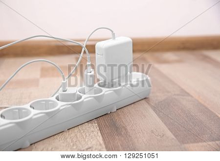 Power strip on floor