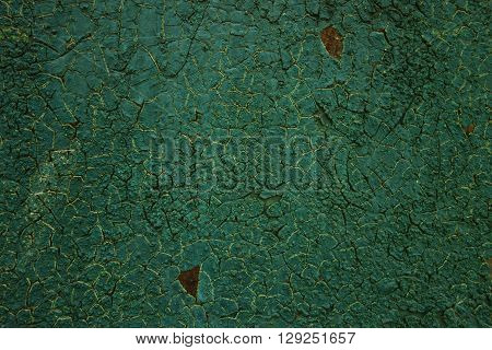 old cracked green paint. Grungy texture. Background