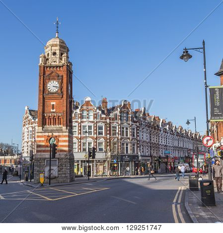 LONDON UK - 10TH MARCH 2015: The clock Tower and Streets in Crouch End North London. People and traffic can be seen.