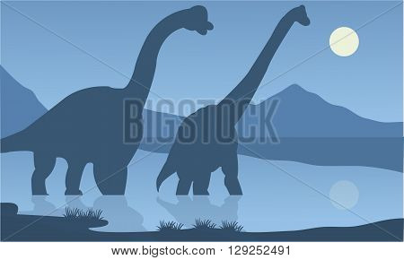 Silhouette of brachiosaurus lake with blue backgrounds