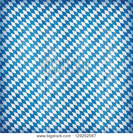 Tradional bavarian colors with diamond pattern. Wooden background for Oktoberfest decoration.
