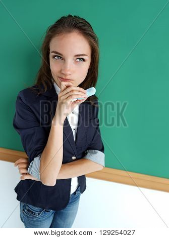 Take thought. Photo beautiful student near blackboard education concept