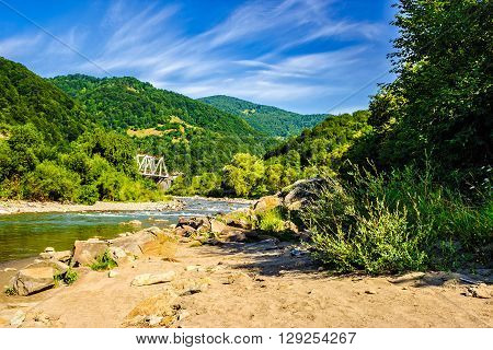 Shore Of A River In Mountain Rural Area