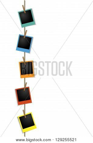 Blank colorful vertical photo frames on a clothesline