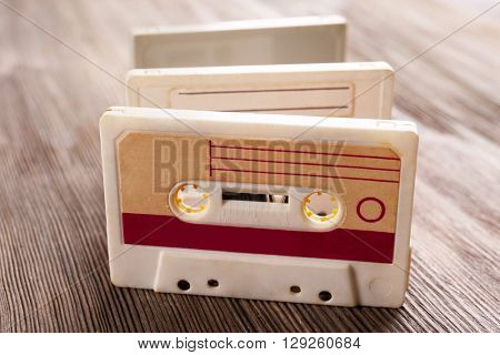Old audio cassette on wooden background