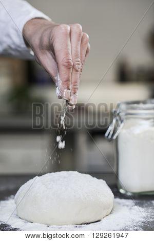 Chef preparing dough in kitchen flour douth Pizza