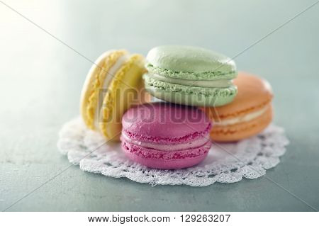 Pile of colorful macarons hazy pastel vintage editing