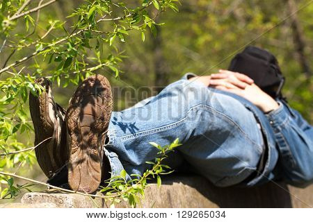 Macro photo of shoe soles. Man lying on nature after a long physical activity