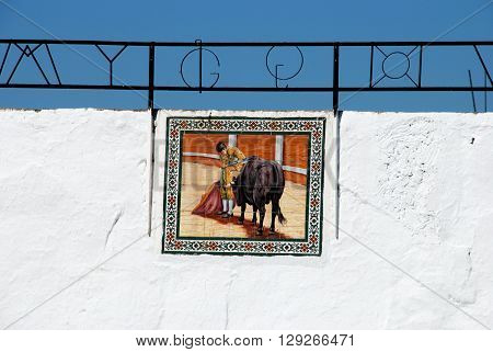 MIJAS, SPAIN - JUNE 14, 2008 - Tiled picture of Matador and bull on the bullring wall Mijas Malaga Province Andalucia Spain Western Europe, June 14, 2008.