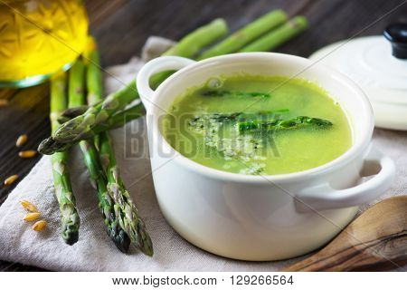 Creamy Asparagus Soup On Wooden Background