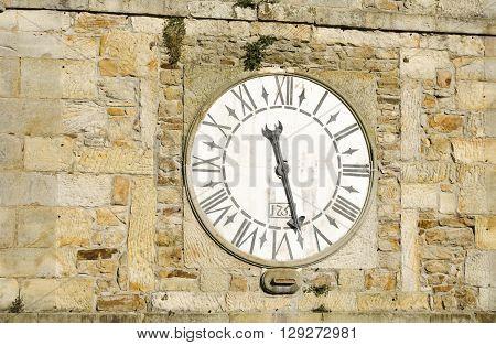 Clock tower, old stone church in Asturias, Spain