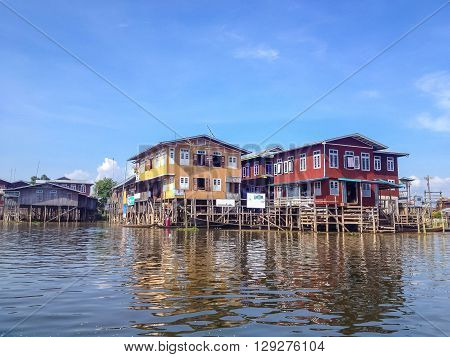 SHAN MYANMAR - MAY 26 : Traditional floating village houses in Inle Lake Myanmar on May 26 2014. Inle Lake is a freshwater lake located in the Nyaungshwe Township of Taunggyi District of Shan State part of Shan Hills in Myanmar.