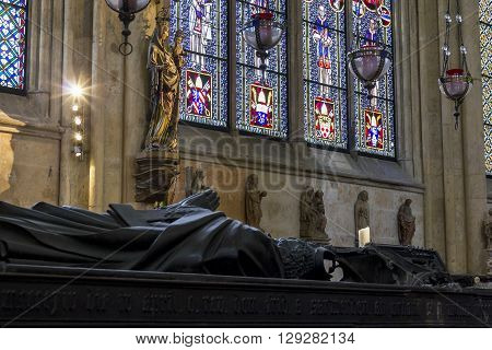 Cologne, Germany - May 16 2013: There are placed along the walls of the cathedral former Archbishop tomb decorated with stained glass windows in the piers are statues of saints May 16, 2013 in Cologne, Germany.