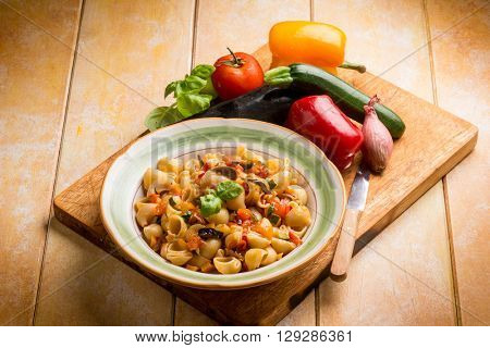 pasta with eggplants zucchinis capsicum and fresh tomatoes